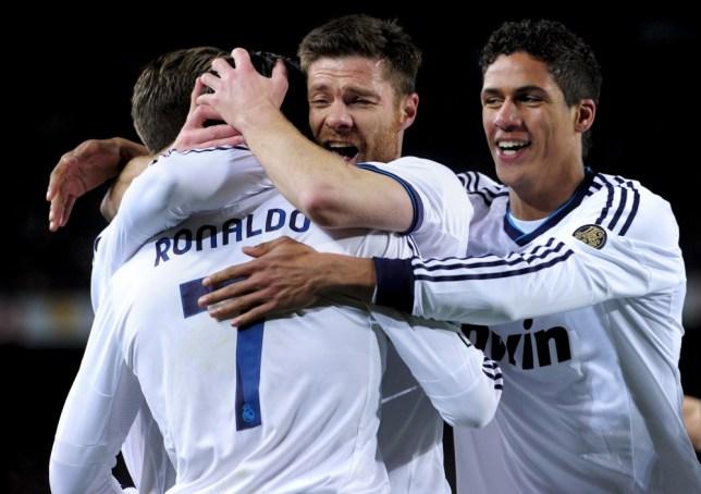 Cristiano Ronaldo (L) is congratuled by his teammates Real Madrid's midfielder Xabi Alonso