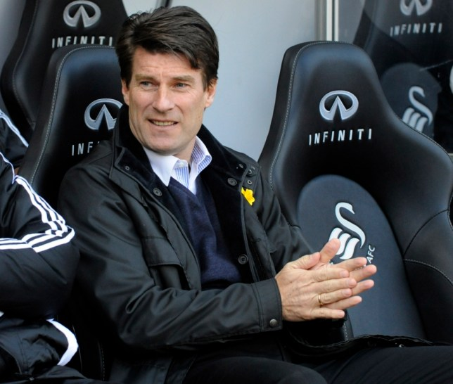 "Swansea City's manager Michael Laudrup watches the match during their English Premier League soccer match against Newcastle United at the Liberty Stadium in Swansea, March 2, 2013. REUTERS/Rebecca Naden (BRITAIN - Tags: SPORT SOCCER) FOR EDITORIAL USE ONLY. NOT FOR SALE FOR MARKETING OR ADVERTISING CAMPAIGNS. NO USE WITH UNAUTHORIZED AUDIO, VIDEO, DATA, FIXTURE LISTS, CLUB/LEAGUE LOGOS OR ""LIVE"" SERVICES. ONLINE IN-MATCH USE LIMITED TO 45 IMAGES, NO VIDEO EMULATION. NO USE IN BETTING, GAMES OR SINGLE CLUB/LEAGUE/PLAYER PUBLICATIONS"