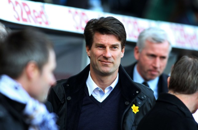 "Swansea City's Danish manager Michael Laudrup looks on before the English Premier League football match between Swansea City and Newcastle United at Liberty Stadium in Swansea, south Wales, on March 2, 2013. Swansea won the game 1-0. AFP PHOTO/GEOFF CADDICK RESTRICTED TO EDITORIAL USE. No use with unauthorized audio, video, data, fixture lists, club/league logos or ""live"" services. Online in-match use limited to 45 images, no video emulation. No use in betting, games or single club/league/player publications.GEOFF CADDICK/AFP/Getty Images"