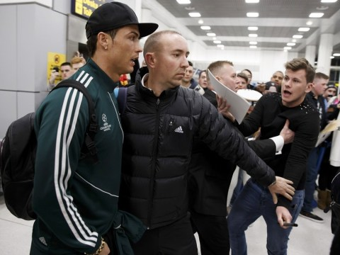 Cristiano Ronaldo gets mobbed as he arrives back in Manchester