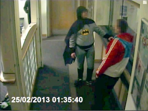 Batman hands over wanted man to police – then disappears