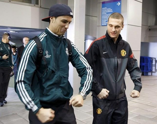 Cristiano Ronaldo (L) of Real Madrid and Nemanja Vidic of Manchester United
