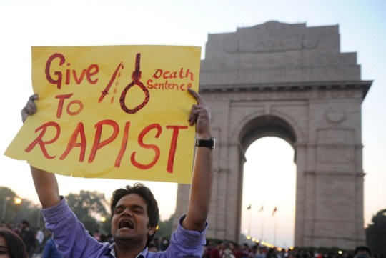 (FILES) This picture taken on December 19, 2012 shows Indian students and activists carrying placards at India Gate during a protest following the gang-rape of a student in New Delhi. The main accused in the fatal gang-rape of a student on a bus in New Delhi in December hanged himself in jail on March 11, 2013 while in solitary confinement, prompting outrage from the victim's family. Ram Singh, one of six people on trial over the shocking attack, was found dead shortly before dawn after making a noose out of his clothing, according to officials at Delhi's top-security Tihar jail.            AFP PHOTO/ SAJJAD HUSSAIN / FILES   SAJJAD HUSSAIN/AFP/Getty Images
