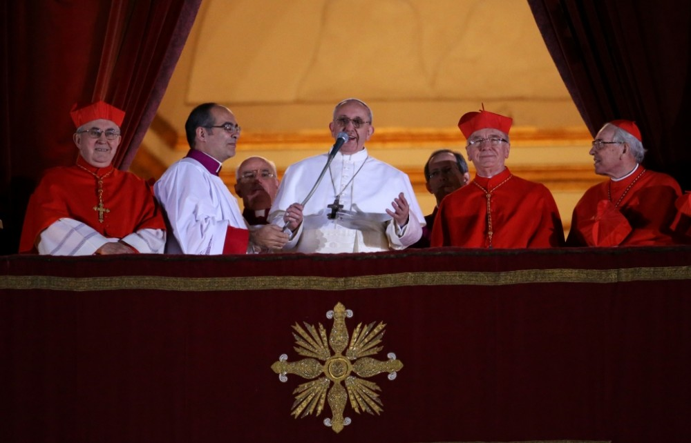 Newly elected Pope Francis I speaks to the waiting crowd from the central balcony of St Peter's Basilica (Getty)