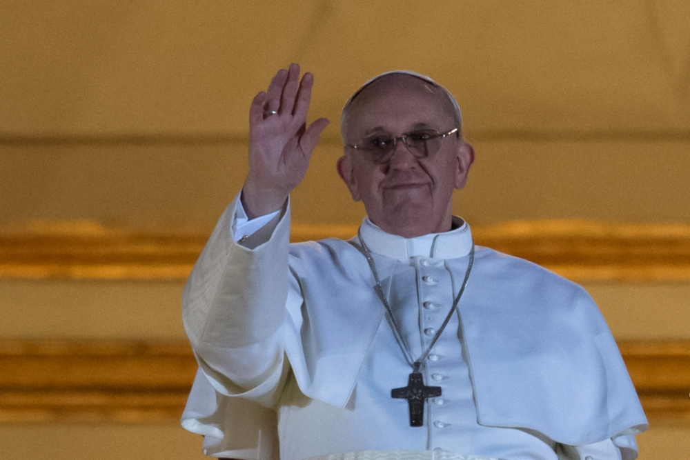 Argentina's Jorge Bergoglio, elected Pope Francis I waves from the window of St Peter's Basilica's balcony after being elected the 266th pope of the Roman Catholic Church on March 13, 2013 at the Vatican.      AFP PHOTO / VINCENZO PINTOVINCENZO PINTO/AFP/Getty Images