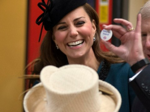 Kate Middleton handed 'Baby on board' badge during Tube visit with the Queen