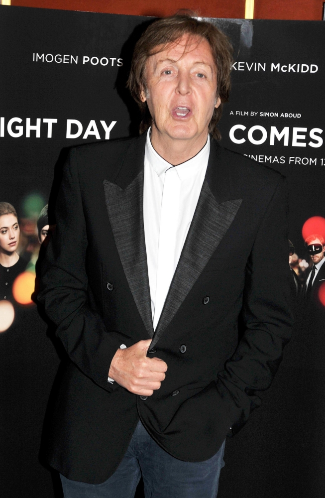 File photo dated 26/6/2012 of Sir Paul McCartney who has revealed how he had planned to get the musical pioneer behind the Doctor Who theme to make one of The Beatles' most famous songs, Yesterday, into an early piece of electronica. PRESS ASSOCIATION Photo. Issue date: Friday March 22, 2013. He told how he approached Delia Derbyshire from the BBC Radiophonic Workshop to work on the song, even visiting her home, after showing an interest in experimental music. See PA story SHOWBIZ Beatles. Photo credit should read: John Stillwell/PA Wire