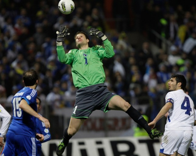 Bosnia's goalkeeper Asmir Begovic catches ball during World Cup 2014 Group G qualifying soccer match at Stadium Bilino Polje in Zenica, Bosnia, on  Friday, March 22, 2013. (AP Photo/Amel Emric)