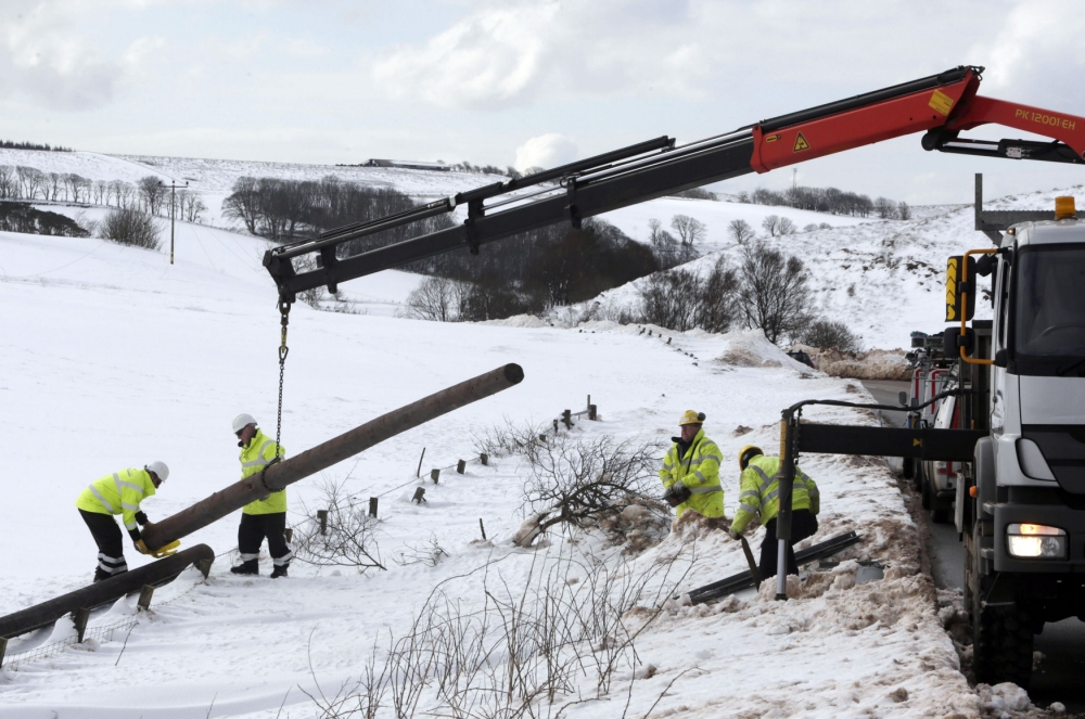 Workers fix a power line in Kintyre in Scotland.