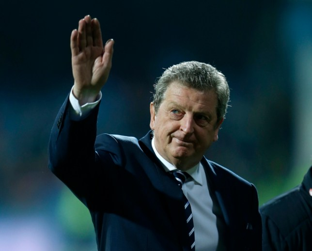 England manager Roy Hodgson salutes the travelling fans on the pitch before their 2014 World Cup qualifying soccer match against Montenegro at the City Stadium in Podgorica, March 26, 2013.  REUTERS/Eddie Keogh (MONTENEGRO - Tags: SPORT SOCCER)