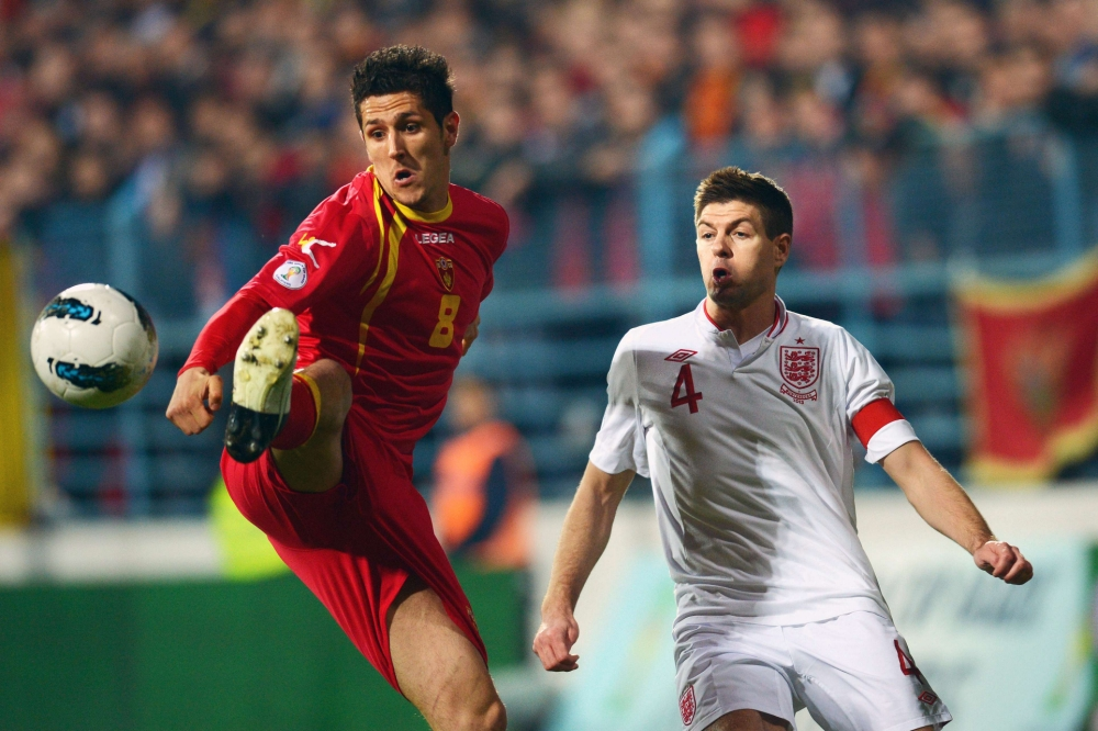 Montenegro's forward Stevan Jovetic (L) vies with England's midfielder Steven Gerrard (R) during their World Cup 2014 qualification football match at Podgorica stadium in Podgorica on March 26, 2013.    AFP PHOTO / DIMITAR DILKOFFDIMITAR DILKOFF/AFP/Getty Images