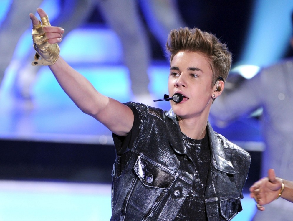 FILE ñ MARCH 26, 2013: Singer Justin Bieber is being investigated by the Los Angeles County Sheriffís Department regarding a battery complaint filed by Justin Bieberís neighbor after a verbal altercation on March 26, 2013 in Calabasas, California. UNIVERSAL CITY, CA - JULY 22:  Singer Justin Bieber accepts the Male Summer Music Star award onstage during the 2012 Teen Choice Awards at Gibson Amphitheatre on July 22, 2012 in Universal City, California.  (Photo by Kevin Winter/Getty Images)