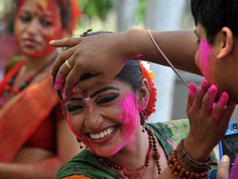 Gallery: Revellers cover each other in a rainbow of colours as they celebrate Holi in India