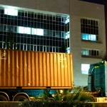 An armed police officer guards several trucks carrying containers after arriving at the country's Central Bank in Nicosia,Cyprus, on Wednesday, March 27, 2013. The contents of the trucks could not be independently confirmed, although state-run television reported they were carrying cash flown in from Frankfurt for the bank reopening.