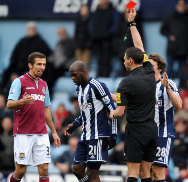 LONDON, ENGLAND - MARCH 30:  Youssouf Mulumbu of West Bromwich Albion is sent off by referee Andre Marriner during the Barclays Premier League match between West Ham United and West Bromwich Albion at the Boleyn Ground on March 30, 2013 in London, England.  (Photo by Steve Bardens/Getty Images)