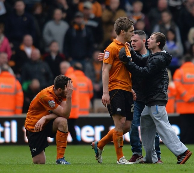 WOLVERHAMPTON, ENGLAND - APRIL 27:  Kevin Doyle is confronted by fans as team-mate Roger Johnson of Wolverhampton Wanderers looks dejected at the end of the npower Championship match between Wolverhampton Wanderers and Burnley at Molineux on April 27, 2013 in Wolverhampton, England. Getty Images