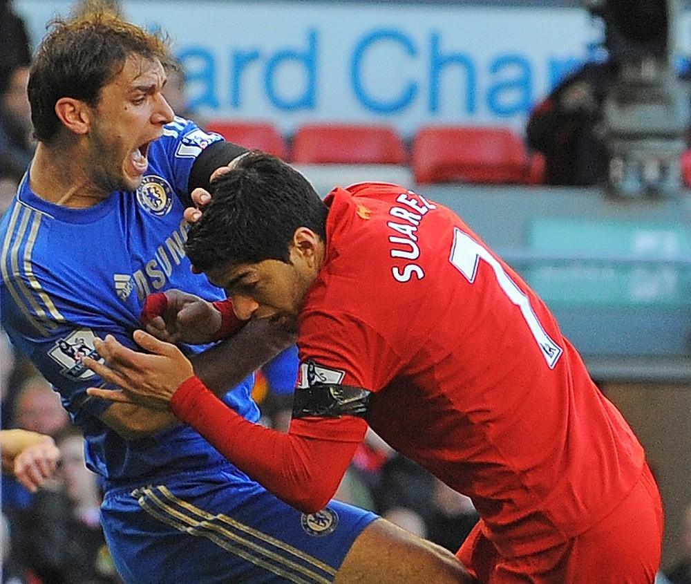 Chomp: Liverpool's Luis Suarez bites Branislav Ivanovic (Picture: AFP/Getty Images)