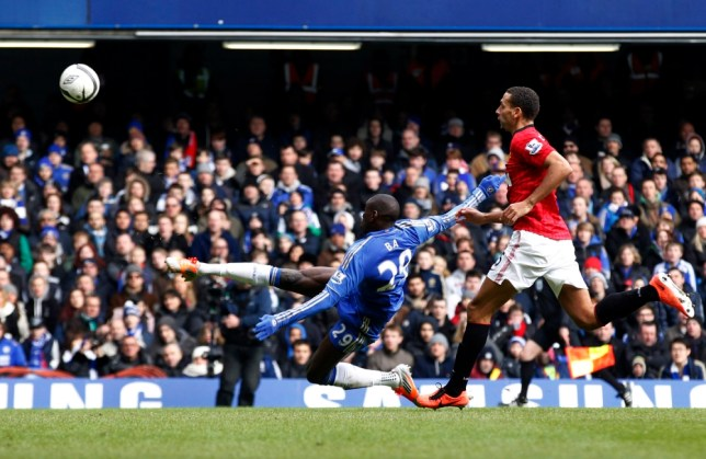 Chelsea's Demba Ba, left, shoots to score against Manchester United during their English FA Cup quarter final replay soccer match at Stamford Bridge, London, Monday, April 1, 2013. (AP Photo/Sang Tan)