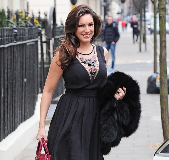 Kelly Brook flashes the cleavage yet again as she heads to Celebrity Juice studios