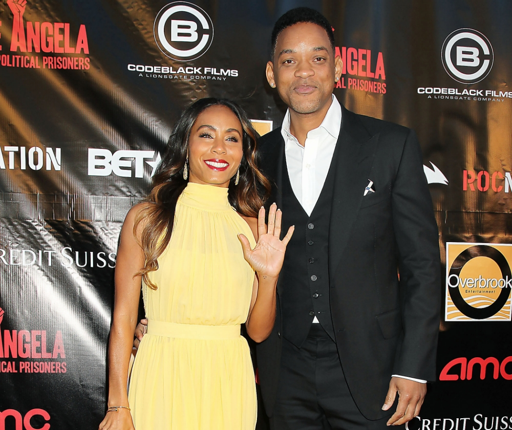 """This April 3, 2013 photo released by Starpix shows producer Jada Pinkett Smith, left, and her husband Will Smith at the premiere of """"Free Angela and All Political Prisoners,"""" at the Schomburg Center in New York. (AP Photo/Starpix, Dave Allocca)"""