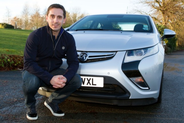 Gary Neville with his plug-in  hybrid car (Picture: Getty)