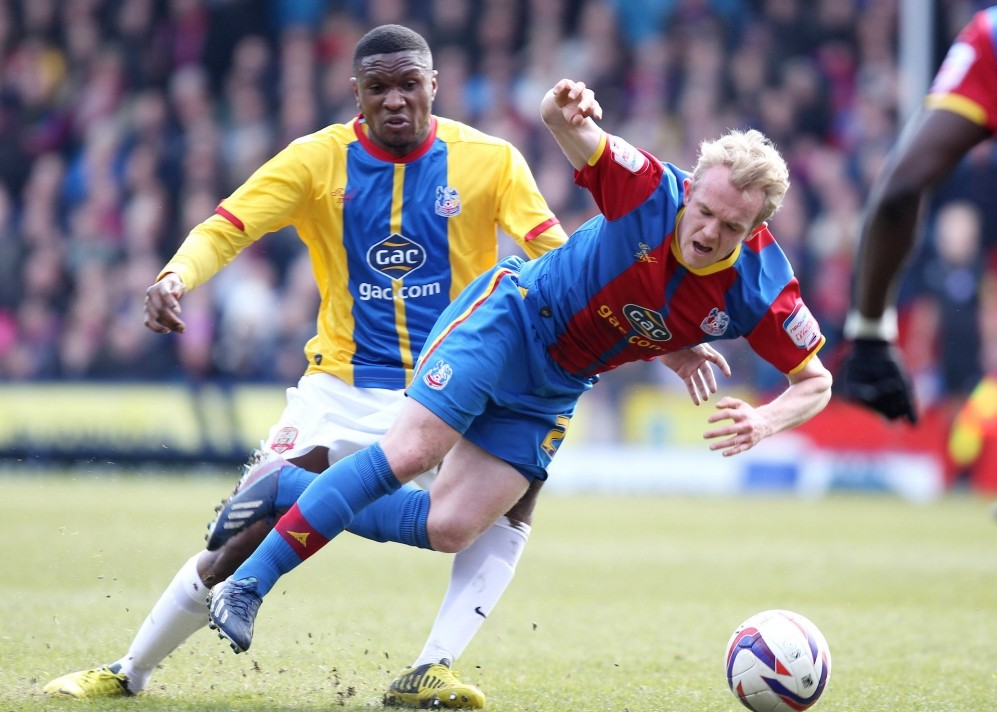 Football - Crystal Palace v Barnsley - npower Football League Championship  - Selhurst Park - 6/4/13  Crystal Palace's Jonathan Williams (R) in action with Barnsley's Kelvin Etuhu from which Crystal Palace are awarded penalty kick  Mandatory Credit: Action Images / Frances Leader  Livepic  EDITORIAL USE ONLY. No use with unauthorized audio, video, data, fixture lists, club/league logos or ìliveî services. Online in-match use limited to 45 images, no video emulation. No use in betting, games or single club/league/player publications.  Please contact your account representative for further details.