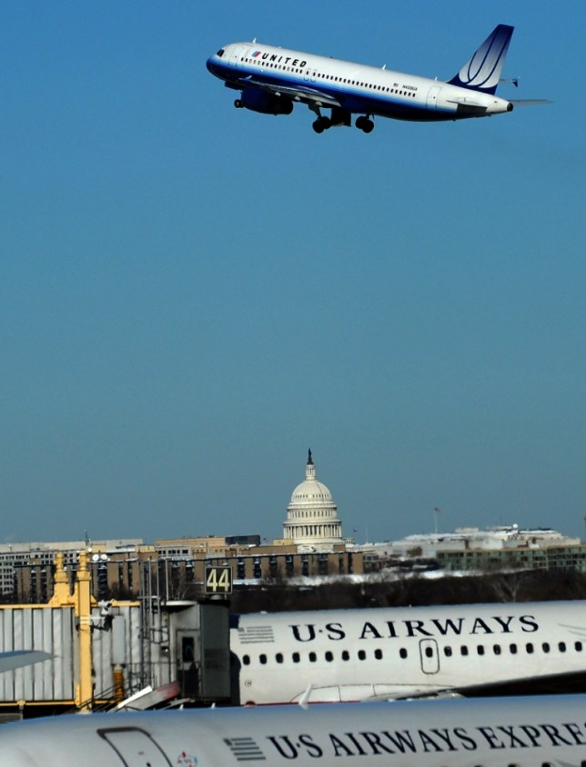 A United airlines flight takes off at the Regan National airport in Arlington, Virginia, on February 8, 2010. The US east coast braced on February 8, for a new storm after record snowfall left thousands of people shivering in the dark without power, transportation paralyzed and the federal government shut down. The US capital remained largely snow-locked, while many local governments, businesses and schools were also shuttered across the mid-Atlantic region. AFP PHOTO/Jewel SAMAD (Photo credit should read JEWEL SAMAD/AFP/Getty Images)