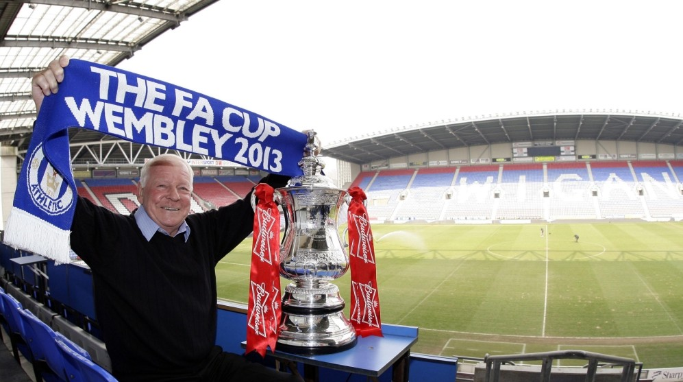 Football - Wigan Athletic FA Cup Semi Final Preview - DW Stadium - 9/4/13  Wigan Athletic chairman Dave Whelan with the Budweiser FA Cup during the preview  Mandatory Credit: Action Images / Craig Brough  Livepic