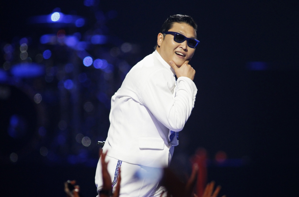 "South Korean rapper-singer Psy performs during the 2012 iHeart Radio Music Festival at the MGM Grand Garden Arena in Las Vegas, Nevada in this September 21, 2012 file photograph. Psy, 35, released his much-anticipated new single titled ""Gentleman"" on April 11, 2013 hoping to repeat the success of ""Gangnam Style"" that made him the biggest star to emerge from the growing K-pop music scene. He will perform ""Gentleman"" in public for the first time on Saturday at a concert at Seoul's World Cup stadium but he has been coy about what dance to expect this time, except to hint that it is based on traditional Korean moves. REUTERS/Steve Marcus/Files (UNITED STATES - Tags: ENTERTAINMENT PROFILE)"