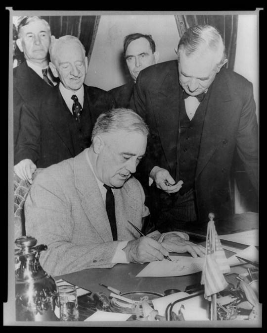 Franklin D Roosevelt signing the declaration of war against Japan (Picture: Freemantle International Distribution)