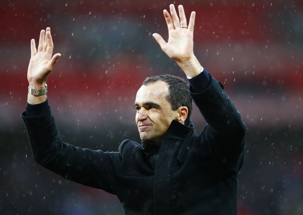 Wigan Athletic's manager Roberto Martinez waves after their FA Cup semi-final soccer match against Millwall at Wembley Stadium in London, April 13, 2013. REUTERS/Darren Staples (BRITAIN - Tags: SPORT SOCCER)