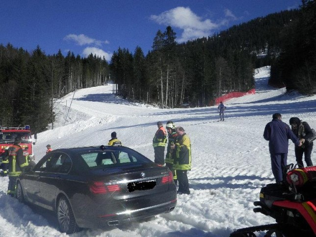 "PARK AND SLIDE: FAMILY PARKS CAR ON SKI PISTE A Kuwaiti tourist who wanted to show his children snow for the first time slipped up when he drove his luxury hire car straight onto a ski piste. Baffled skiers found the stranded top-of-the-range BMW 7 series abandoned  in the middle of the slope at Garmisch-Partenkirchen, Germany. Police eventually tracked it down to a wealthy family of five from the desert kingdom Kuwait visiting the resort on a day trip from Munich. ""The father wanted to show his children snow, which they had never seen before,"" said a police spokesman. ""Unfortunately he drove as far as he could up a forest footpath and then lost control and slid sideways onto the piste,"" ""It is a miracle that no damage was done. If it had entered the piste just a few minutes earlier the car would have slipped right down the slope as it was much steeper. The car would have lost grip and slid out of control and the consequences would have been much worse,"" ""They are very lucky that they managed to escape without injury. It was a very thoughtless thing to do. The drivers actions put his family's lives at risk and endangered other skiers."" he added. Officials say the family will be charged the full cost of the 3,000 GBP rescue by firefighters. (ends)"