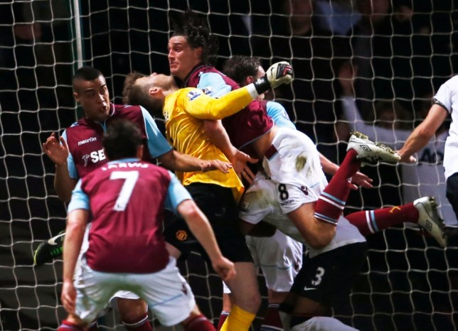 """Manchester United's goalkeeper David de Gea (C, yellow) is challenged by West Ham United's Andy Carroll during their English Premier League soccer match at The Boleyn Ground in London April 17, 2013.     REUTERS/Eddie Keogh (BRITAIN - Tags: SPORT SOCCER) FOR EDITORIAL USE ONLY. NOT FOR SALE FOR MARKETING OR ADVERTISING CAMPAIGNS. NO USE WITH UNAUTHORIZED AUDIO, VIDEO, DATA, FIXTURE LISTS, CLUB/LEAGUE LOGOS OR """"LIVE"""" SERVICES. ONLINE IN-MATCH USE LIMITED TO 45 IMAGES, NO VIDEO EMULATION. NO USE IN BETTING, GAMES OR SINGLE CLUB/LEAGUE/PLAYER PUBLICATIONS"""