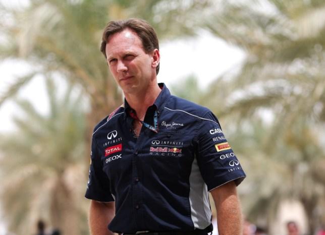 epa03669772 Red Bull Team Principal Christian Horner walks in the paddock at the Sakhir circuit near Manama, Bahrain, 20 April 2013. The 2013 Bahrain Formula One Grand Prix will take place on 21 April 2013.  EPA/VALDRIN XHEMAJ