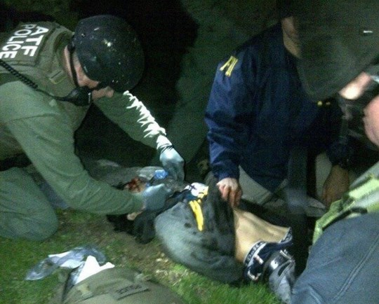 FBI agents check suspect Dzhokhar Tsarnaev after he was finally captured