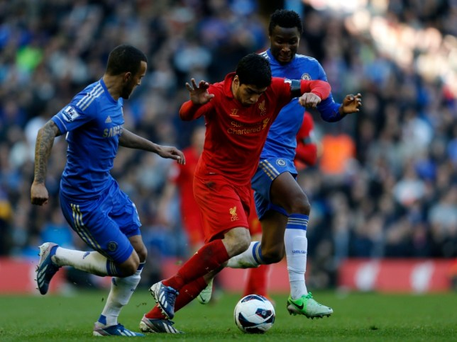"""Chelsea's John Obi Mikel (R) and Ryan Bertrand (L) challenge Liverpool's Luis Suarez during their English Premier League soccer match at Anfield in Liverpool, northern England, April 21, 2013. REUTERS/Phil Noble (BRITAIN - Tags: SPORT SOCCER) FOR EDITORIAL USE ONLY. NOT FOR SALE FOR MARKETING OR ADVERTISING CAMPAIGNS. NO USE WITH UNAUTHORIZED AUDIO, VIDEO, DATA, FIXTURE LISTS, CLUB/LEAGUE LOGOS OR """"LIVE"""" SERVICES. ONLINE IN-MATCH USE LIMITED TO 45 IMAGES, NO VIDEO EMULATION. NO USE IN BETTING, GAMES OR SINGLE CLUB/LEAGUE/PLAYER PUBLICATIONS"""