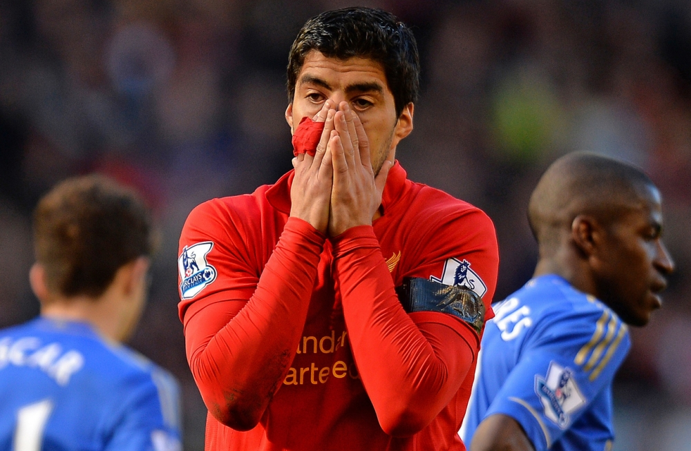 (FILES) In a file picture taken on April 21, 2013 Liverpool's Uruguayan striker Luis Suarez reacts during the English Premier League football match between Liverpool and Chelsea at the Anfield stadium in Liverpool, northwest England. Liverpool striker Luis Suarez has been suspended for 10 matches for biting Chelsea's Branislav Ivanovic in last weekend's English Premier League match at Anfield, the Football Association said on April 24, 2013.  AFP PHOTO / ANDREW YATES  RESTRICTED TO EDITORIAL USE. No use with unauthorized audio, video, data, fixture lists, club/league logos or ìliveî services. Online in-match use limited to 45 images, no video emulation. No use in betting, games or single club/league/player publications.ANDREW YATES/AFP/Getty Images