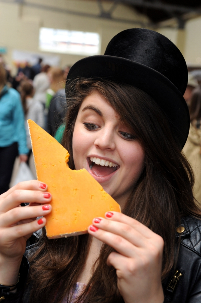 Woman biting cheese
