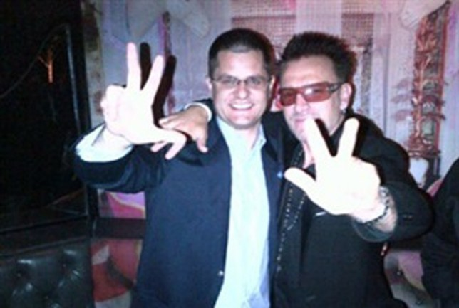 United Nations chief Vuk Jeremic poses with the Bono lookalike