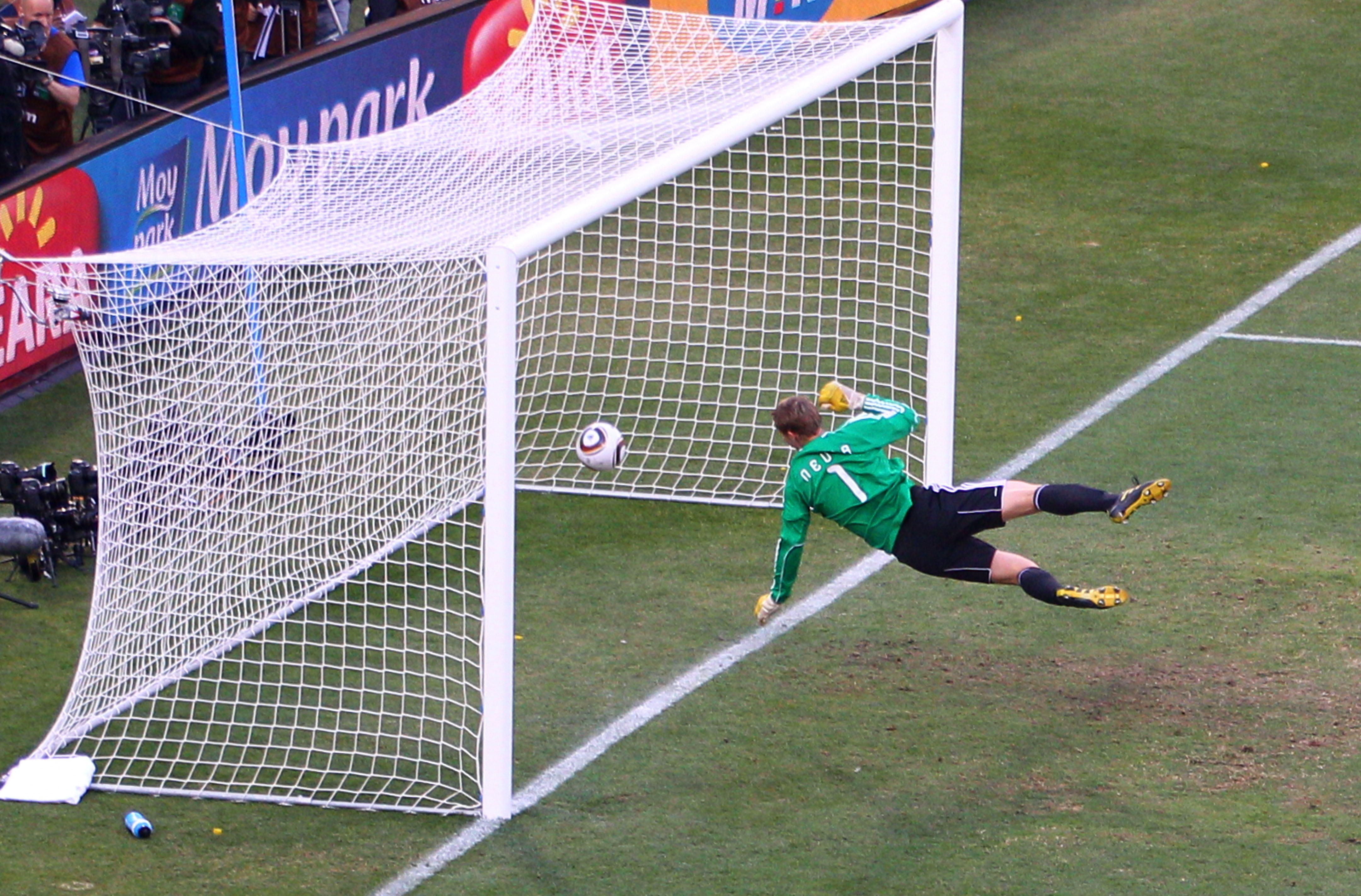 Manuel Neuer of Germany watches the ball bounce over the line fr