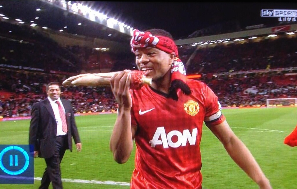 Patrice Evra celebrates Manchester United title by mocking Luis Suarez with severed arm