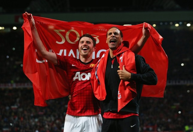 MANCHESTER, ENGLAND - APRIL 22: Michael Carrick (L) and Rio Ferdinand of Manchester United celebrate winning the Premier League title after the Barclays Premier League match between Manchester United and Aston Villa at Old Trafford on April 22, 2013 in Manchester, England. Getty Images