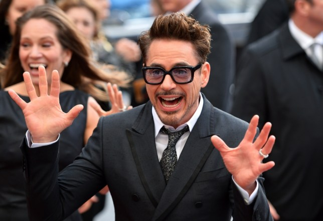 "US actor Robert Downey Jr. poses for picture on the red carpet as he arrives for the premier of his latest film ""Iron Man 3"" in Leicester Square in central London in this April 18, 2013. ""Iron Man 3"" is expected to launch America's summer blockbuster season with a bang this weekend, having already taken global box offices by storm, industry analysts say. Robert Downey Jr returns as the metal-suited Marvel superhero, in a sequel to the last ""Iron Man"" movie in 2010, but also playing off the back of last year's comic-book mega hit ""The Avengers,"" which also featured him. The film, starring Gwyneth Paltrow and Ben Kingsley as well, has already made nearly $200 million around the world in the last week, and could earn a similar sum in its first weekend in North America. AFP PHOTO/LEON NEALLEON NEAL/AFP/Getty Images"