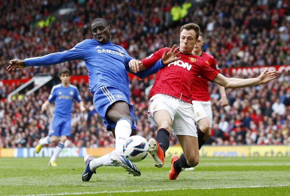 Football - Manchester United v Chelsea - Barclays Premier League  - Old Trafford  - 5/5/13  Chelsea's Demba Ba (L) in action with Manchester United's Jonny Evans  Mandatory Credit: Action Images / Jason Cairnduff  Livepic  EDITORIAL USE ONLY. No use with unauthorized audio, video, data, fixture lists, club/league logos or ìliveî services. Online in-match use limited to 45 images, no video emulation. No use in betting, games or single club/league/player publications.  Please contact your account representative for further details.