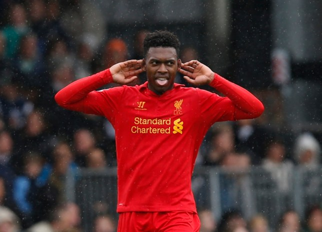 Liverpool's Daniel Sturridge celebrates his third goal against Fulham during their English Premier League soccer match at Craven Cottage, London, Sunday, May 12, 2013. (AP Photo/Sang Tan)