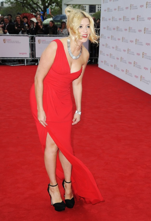Holly Willoughby and Millie Mackintosh lead the Baftas red carpet glamour – despite the wind