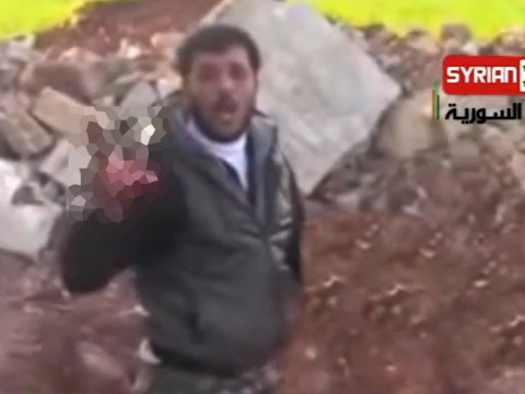 Syria: Warning over spiral of violence as video emerges showing rebel 'eating soldier's heart'
