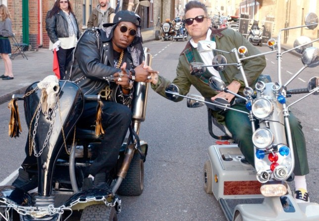 Dizzee Rascal welcomes  Robbie Williams to their video shoot for Goin' Crazy, complete with mobility scooters (Picture: Rex)