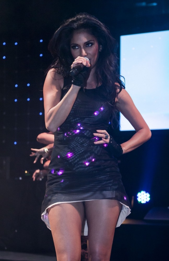 Nicole Scherzinger performs one of her tracks while wearing a dress by CuteCircuit (Picture: Tom Oldham / Rex Features)