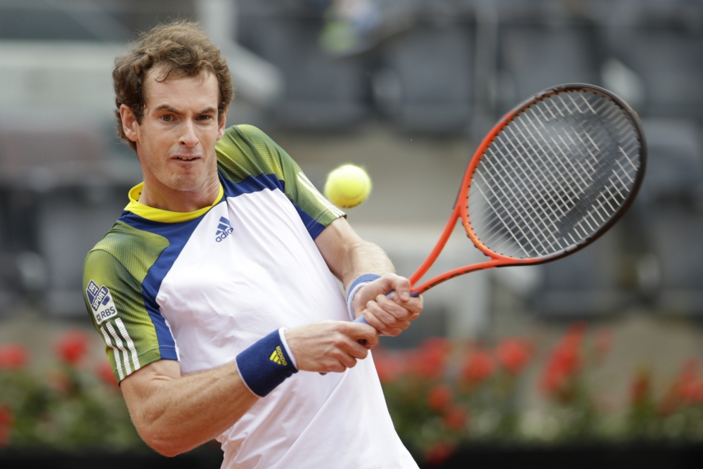 Britain's Andy Murray returns the ball to Spain's Marcel Granollers during their match at the Italian Open tennis tournament in Rome, Wednesday, May 15, 2013. (AP Photo/Andrew Medichini)